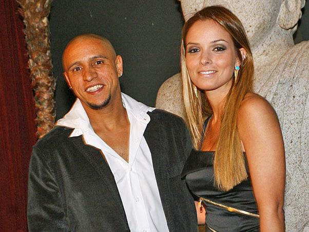 Жена и Роберто Карлос